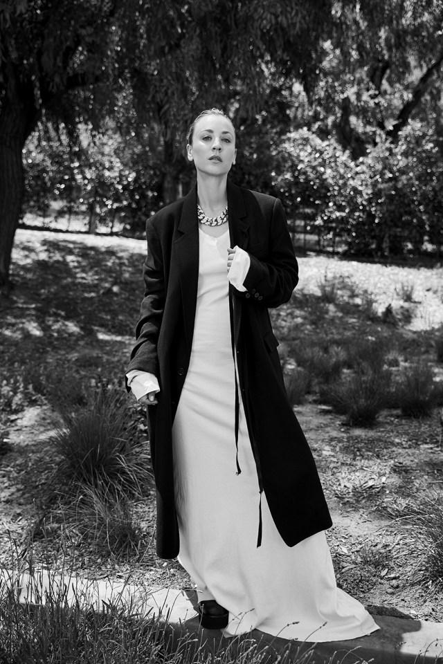 Ann DemeulemeesterÕs wool coat, cotton poplin dress and sleeves. Proenza Schouler slides; Givenchy necklace.