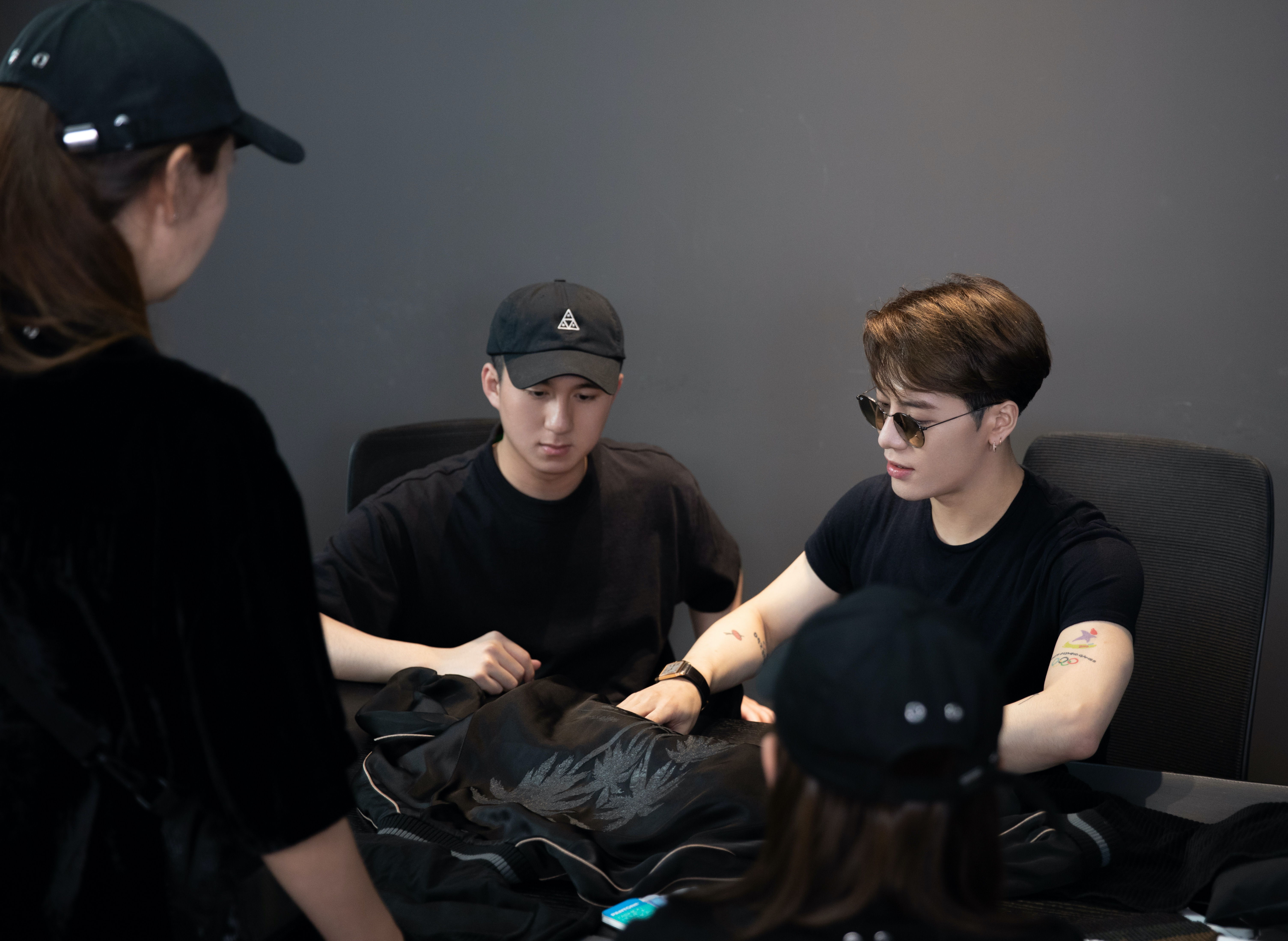 Henry Cheung (left) and Jackson Wang (right) look at the Palm Angels x Team Wang collaboration.