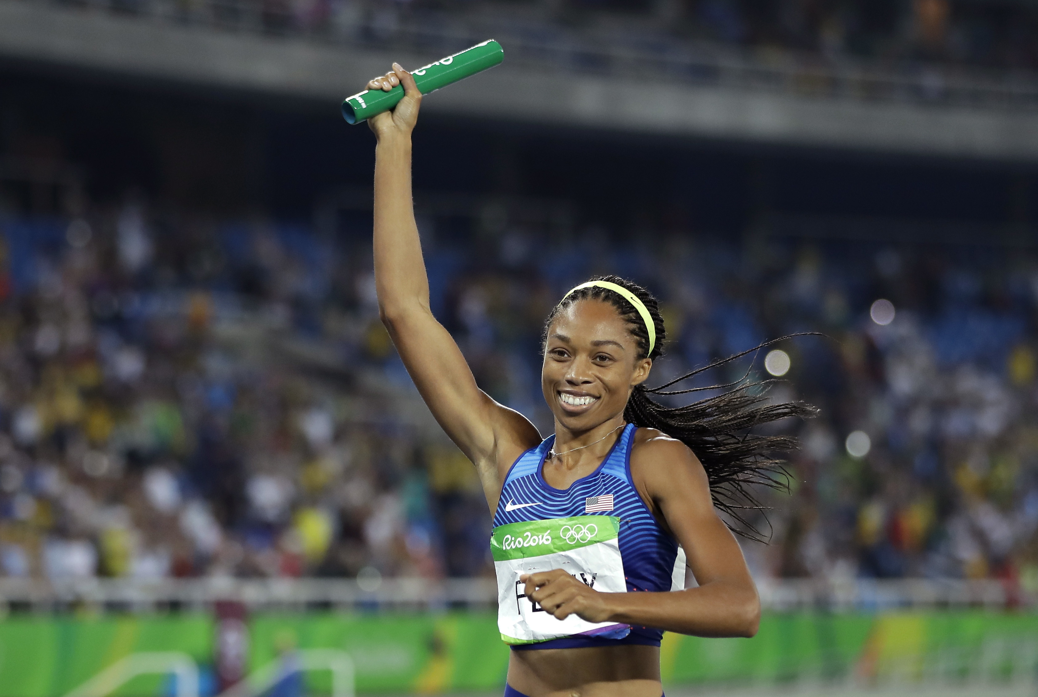 United States' Allyson Felix celebrates after winning the gold medal in the women's 4x400-meter relay final during the athletics competitions of the 2016 Summer Olympics at the Olympic stadium in Rio de Janeiro, Brazil, Saturday, Aug. 20, 2016. (AP Photo/Matt Slocum)