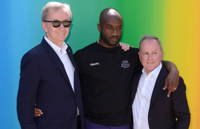 Owner of LVMH Luxury Group Bernard Arnault, Stylist Virgil Abloh and CEO of Louis Vuitton Michael Burke attending the Louis Vuitton Menswear Spring Summer 2019 show as part of Paris Fashion Week in Paris, France on June 21, 2018. Photo by Aurore Marechal/Abaca/Sipa USA(Sipa via AP Images)