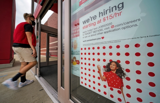 This is a help wanted sign on the door of a Target store in Uniontown, Pa., on Wednesday, Sept. 2, 2020. (AP Photo/Gene J. Puskar)