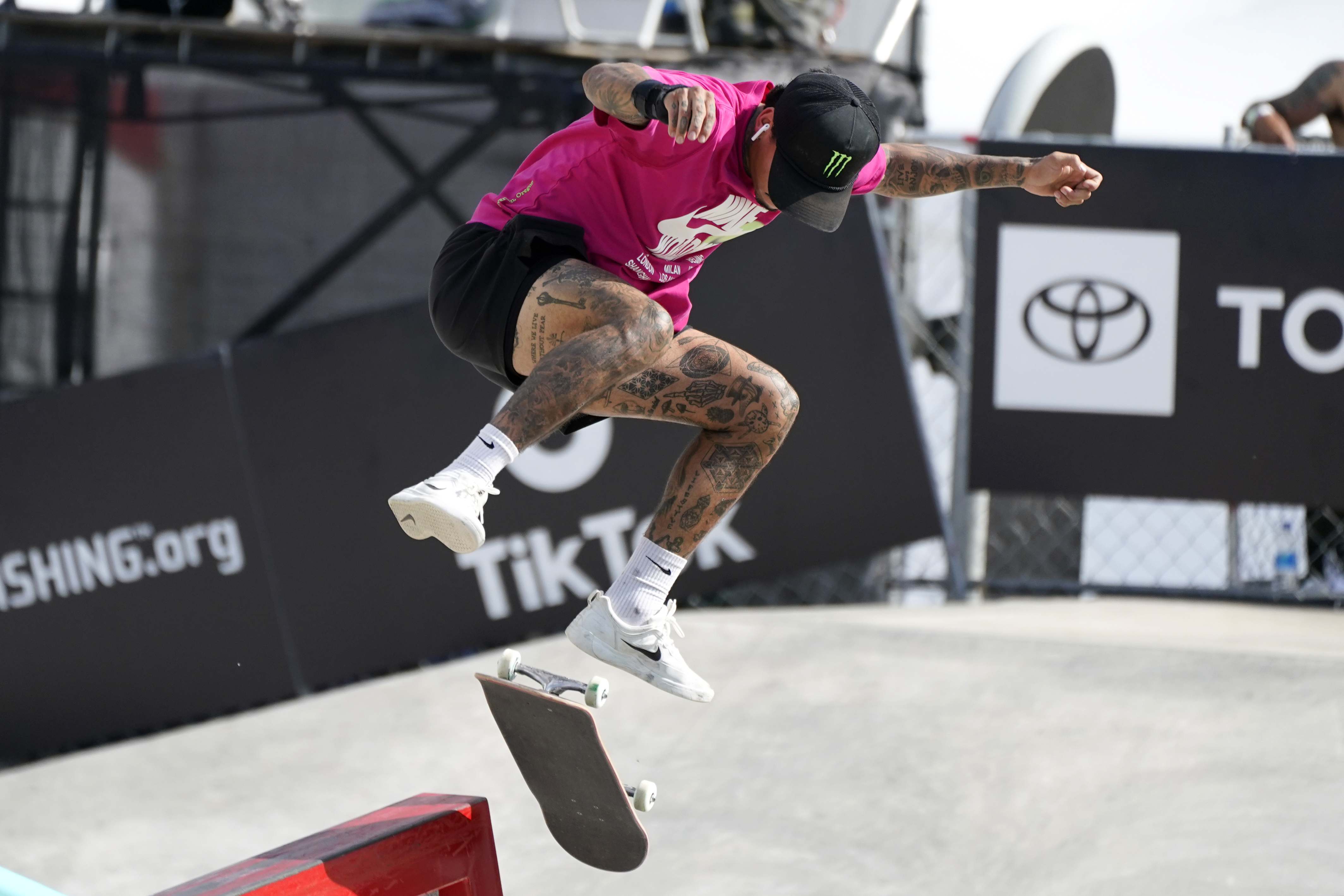 Nyjah Huston, of the United States, competes in the men's Street Final during an Olympic qualifying skateboard event at Lauridsen Skatepark, Sunday, May 23, 2021, in Des Moines, Iowa. (AP Photo/Charlie Neibergall)