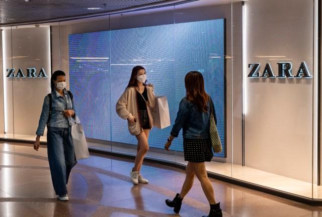 Shoppers walk past the Spanish multinational clothing design retail company by Inditex, Zara store in Hong Kong. (Photo by Budrul Chukrut / SOPA Images/Sipa USA)(Sipa via AP Images)