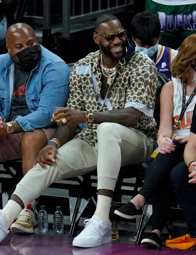 Los Angeles Lakers basketball player LeBron James smiles during the second half of Game 5 of basketball's NBA Finals between the Phoenix Suns and the Milwaukee Bucks, Saturday, July 17, 2021, in Phoenix. (AP Photo/Ross D. Franklin)