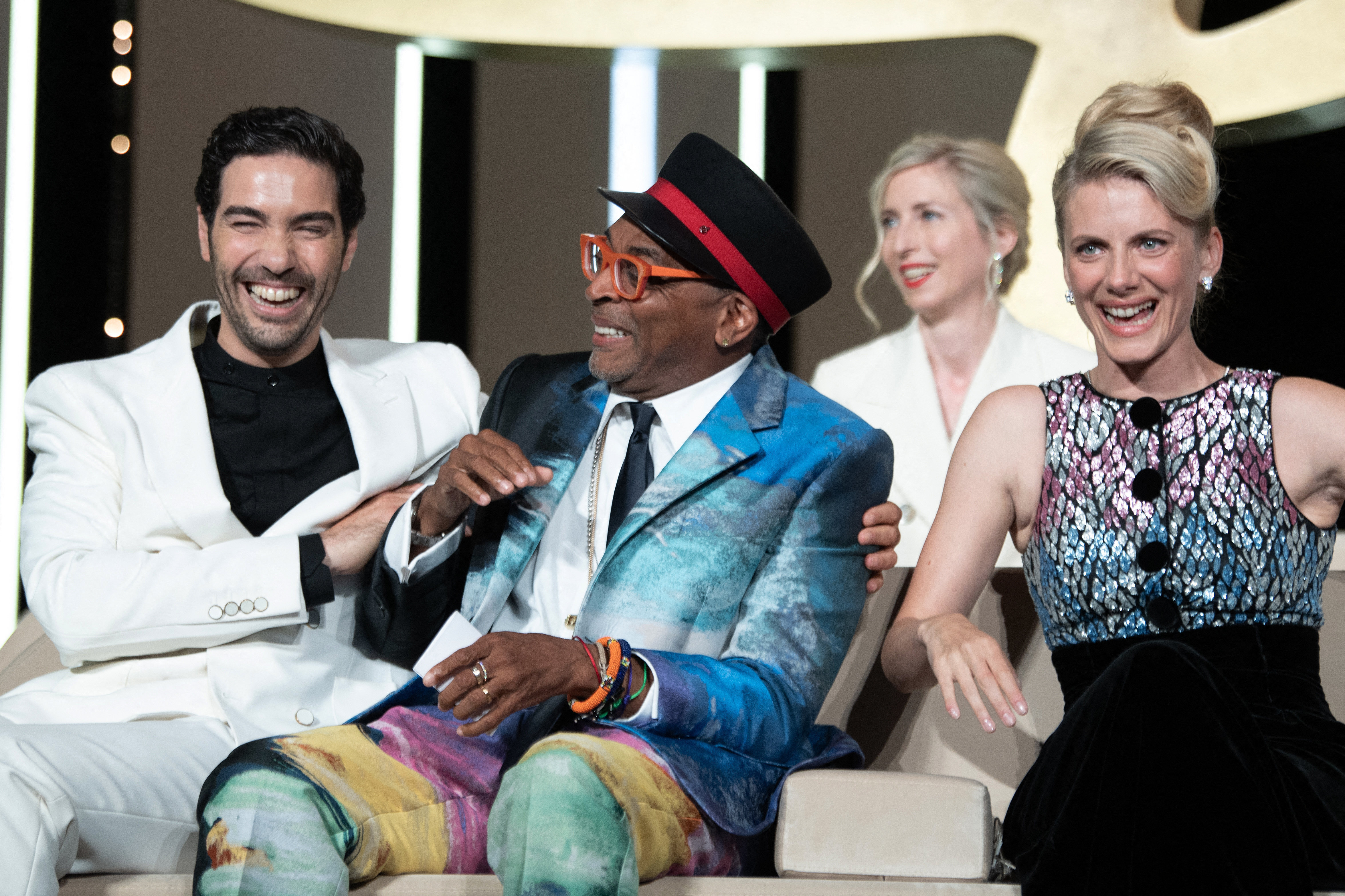 """Jury President Spike Lee and Jury members Tahar Rahim and Melanie Laurent on stage during the closing ceremony of the 74th annual Cannes Film Festival on July 17, 2021 in Cannes, France. Spike Lee accidentally revealed the winner of the festival's top prize, the prestigious Palme d'Or, at the start of the ceremony, after what appeared to be his misunderstanding of a question from the show's host, actress Toria Dillier, who prompted him to reveal the """"first prize."""" Photo by David Niviere/Abaca/Sipa USA(Sipa via AP Images)"""