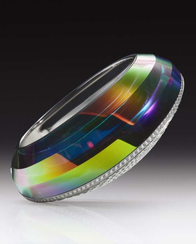 Boucheron's Halo bracelet with pavéd diamonds.
