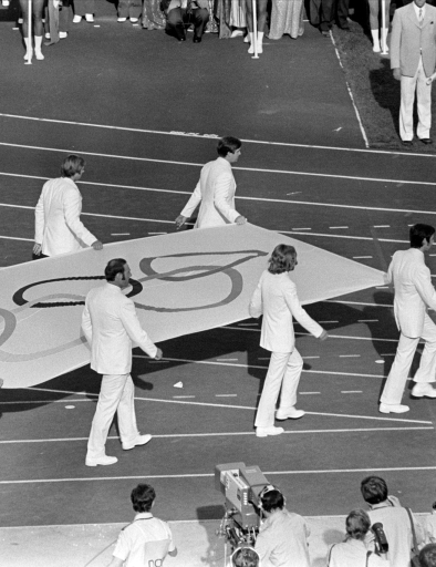 The official Olympic Flag is carried into the stadium by flag bearers during the opening ceremonies for the Summer Olympic Games in Munich, West Germany on July 26, 1972.