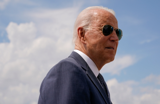 President Joe Biden speaks with members of the press before boarding Air Force One, Friday, July 9, 2021, at Andrews Air Force Base, Md. Biden is spending the weekend at his home in Delaware. (AP Photo/Patrick Semansky)