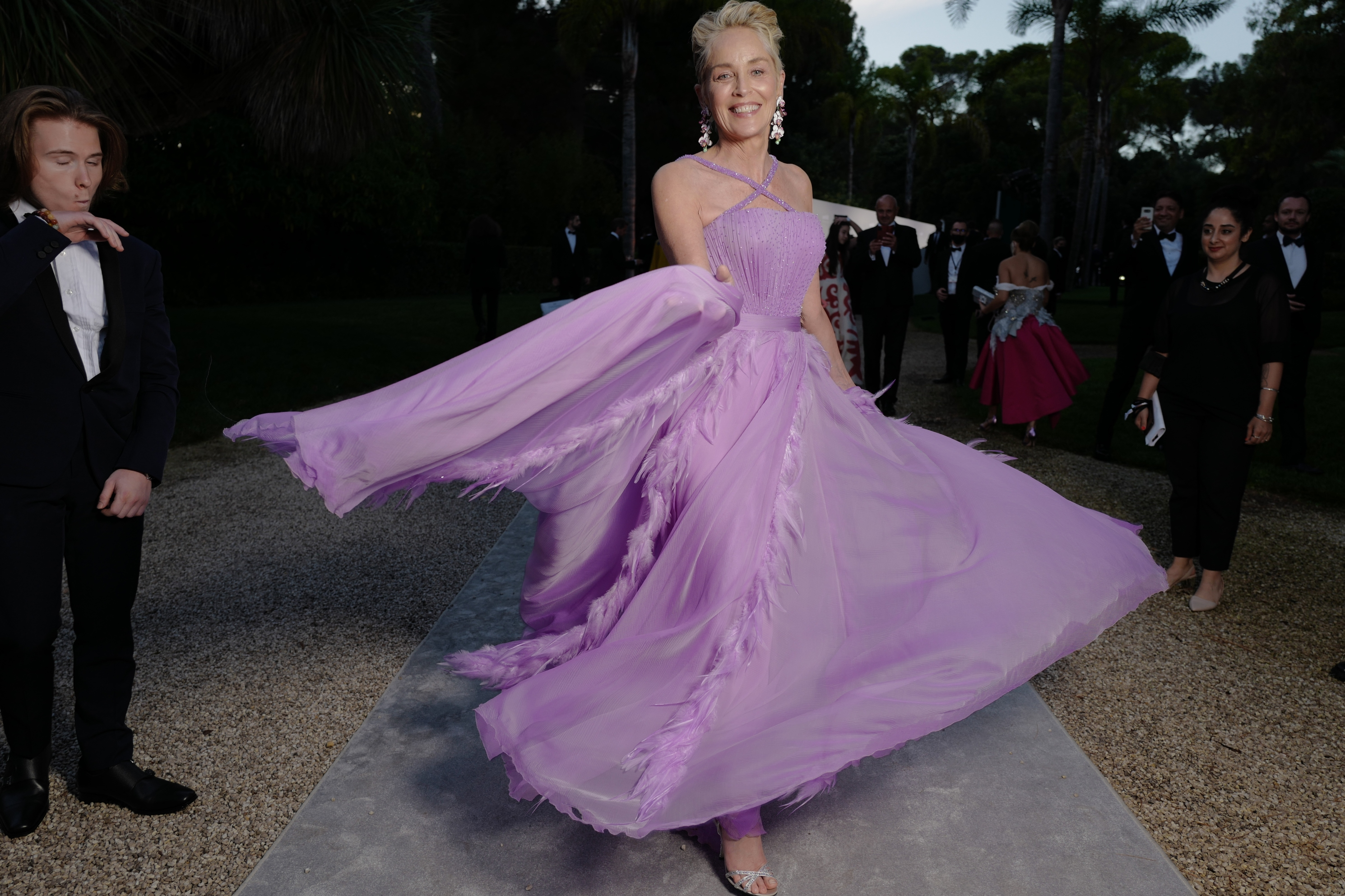 Sharon Stone makes a dramatic entrance at the amfAR gala.