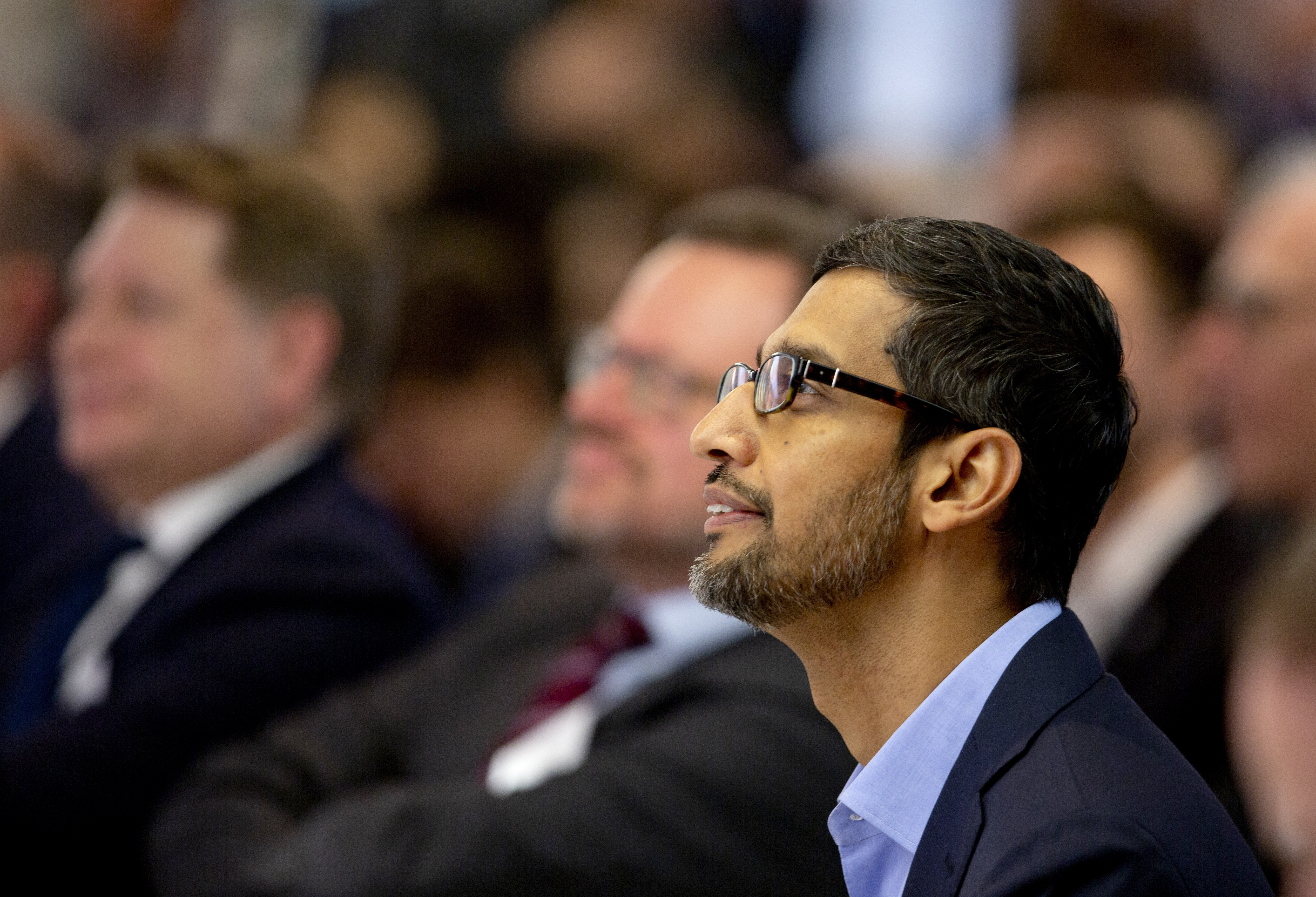 Google's chief executive Sundar Pichai waits to address the audience during an event on artificial intelligence at the Square in Brussels, Monday, Jan. 20, 2020. Google's chief executive called Monday for a balanced approach to regulating artificial intelligence, telling a European audience that the technology brings benefits but also negative consequences. (AP Photo/Virginia Mayo)