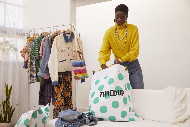 woman filling ThredUp cleanup bag
