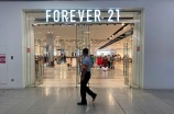Customers shop at a store of Forever 21 to close down at a shopping mall in Beijing, China.