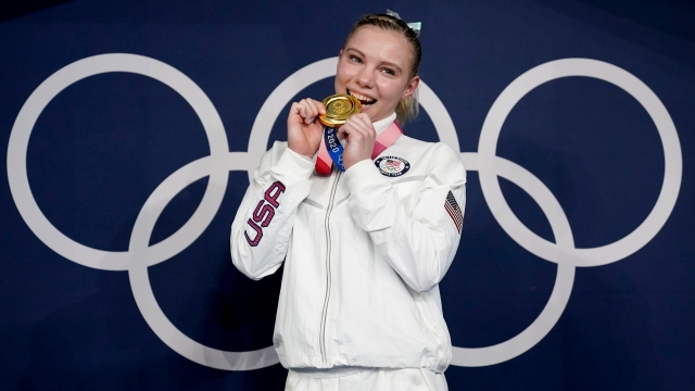 Jade Carey, of the United States, poses after winning the gold medal for the vault during the artistic gymnastics women's apparatus final at the 2020 Summer Olympics, Monday, Aug. 2, 2021, in Tokyo, Japan. (AP Photo/Ashley Landis)