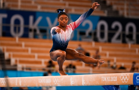 Simone Biles, of the United States, performs in the women's balance beam final of the artistic gymnastics event at the Tokyo 2020 Olympic Games at Ariake Gymnastics Centre in Tokyo, Japan. Grigory Sysoev / Sputnik via AP
