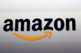 """FILE - This Sept. 6, 2012, file photo, shows the Amazon logo in Santa Monica, Calif.    Amazon Inc. is in """"advanced talks"""" to open its second headquarters in the Washington, D.C., metropolitan area, The Washington Post reported Saturday, Nov. 3, 2018.  Amazon, based in Seattle, is apparently seriously considering an area known as Crystal City. It's a large residential and office complex in Arlington, Virginia, just south of Washington, the Post said, citing unidentified sources.  (AP Photo/Reed Saxon, File)"""