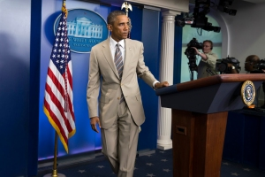 FILE - In this Thursday, Aug. 28, 2014 file photo, President Barack Obama leaves after speaking about the economy, Iraq, and Ukraine, in the James Brady Press Briefing Room of the White House in Washington, before convening a meeting with his national security team on the militant threat in Syria and Iraq. Obama's summer fashion choice, not unprecedented among presidents - himself included - was the talk of social media, Thursday. Other presidents who have taken on tan include Bill Clinton, Ronald Reagan, George H. W. Bush, George W. Bush and Dwight Eisenhower. (AP Photo/Evan Vucci, file)