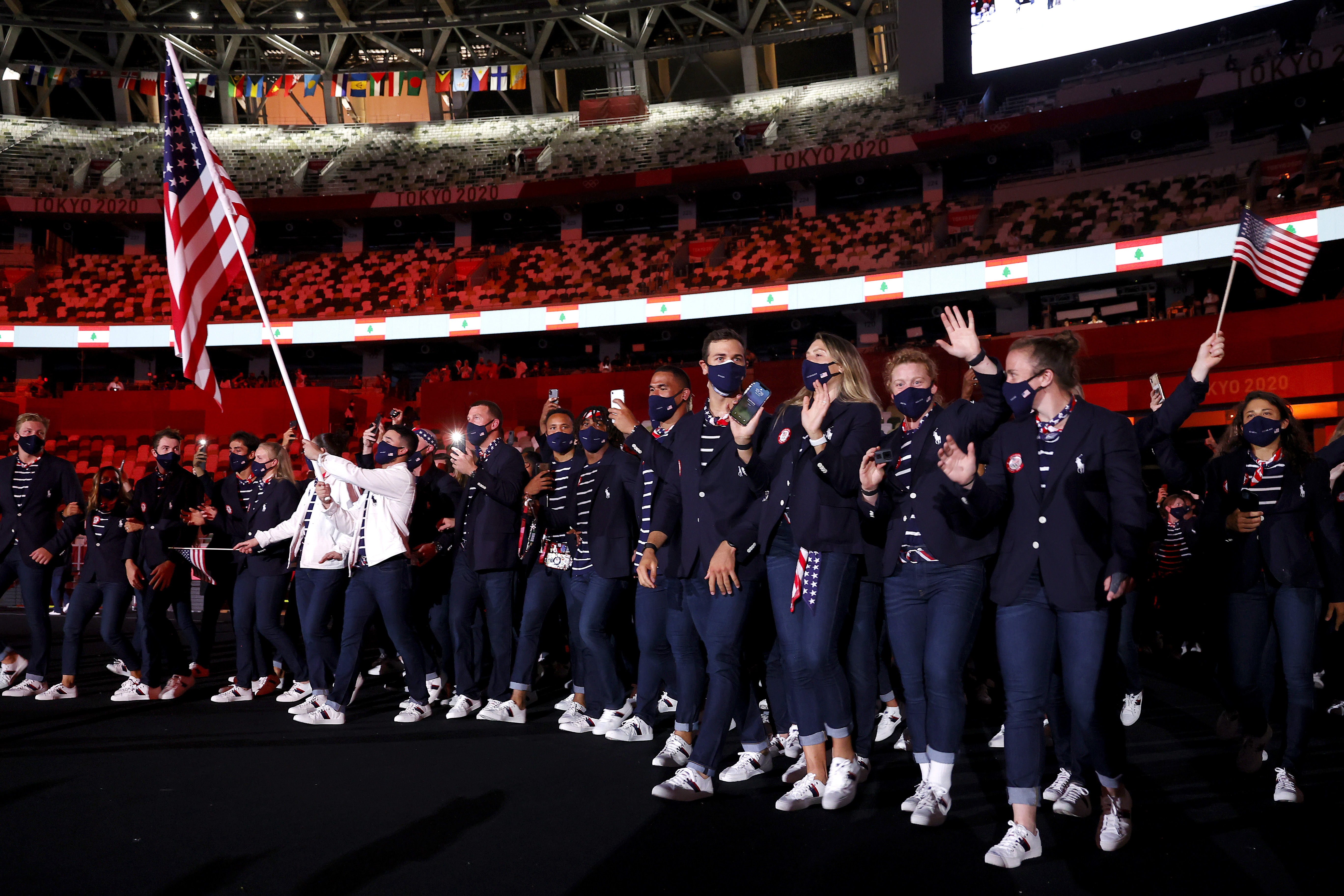 TOKYO, JAPAN - JULY 23: Flag bearers Sue Bird and Eddy Alvares of Team United States lead their team out during the Opening Ceremony of the Tokyo 2020 Olympic Games at Olympic Stadium on July 23, 2021 in Tokyo, Japan. (Photo by Jamie Squire/Getty Images)