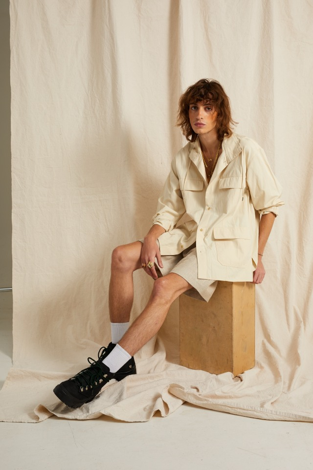 Deveaux's cotton and polyurethane jacket and R.Swiader's linen shorts. Reese Cooper boots.