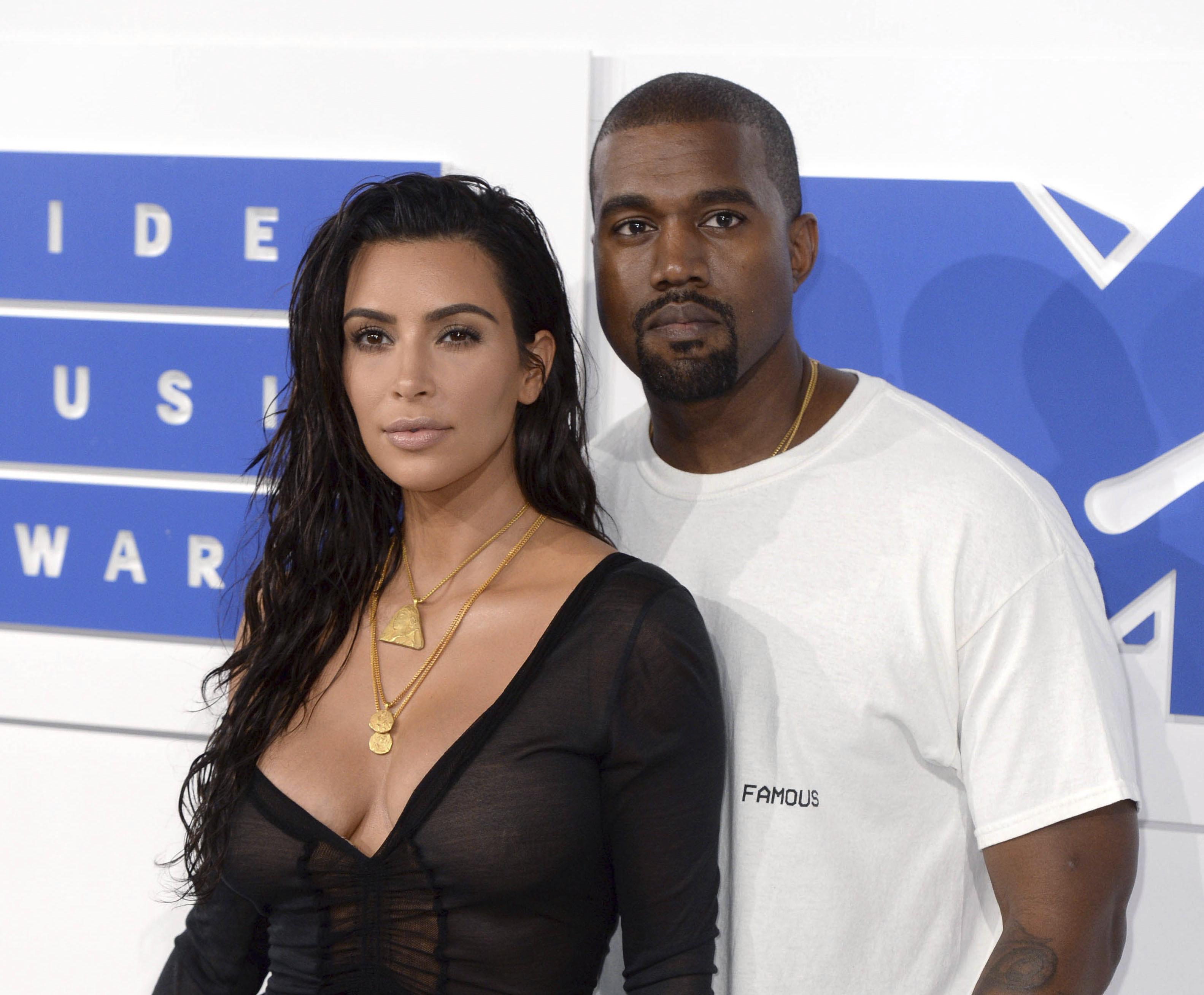 Kim Kardashian West Attends Kanye West Event in Wedding Dress: Reports – WWD