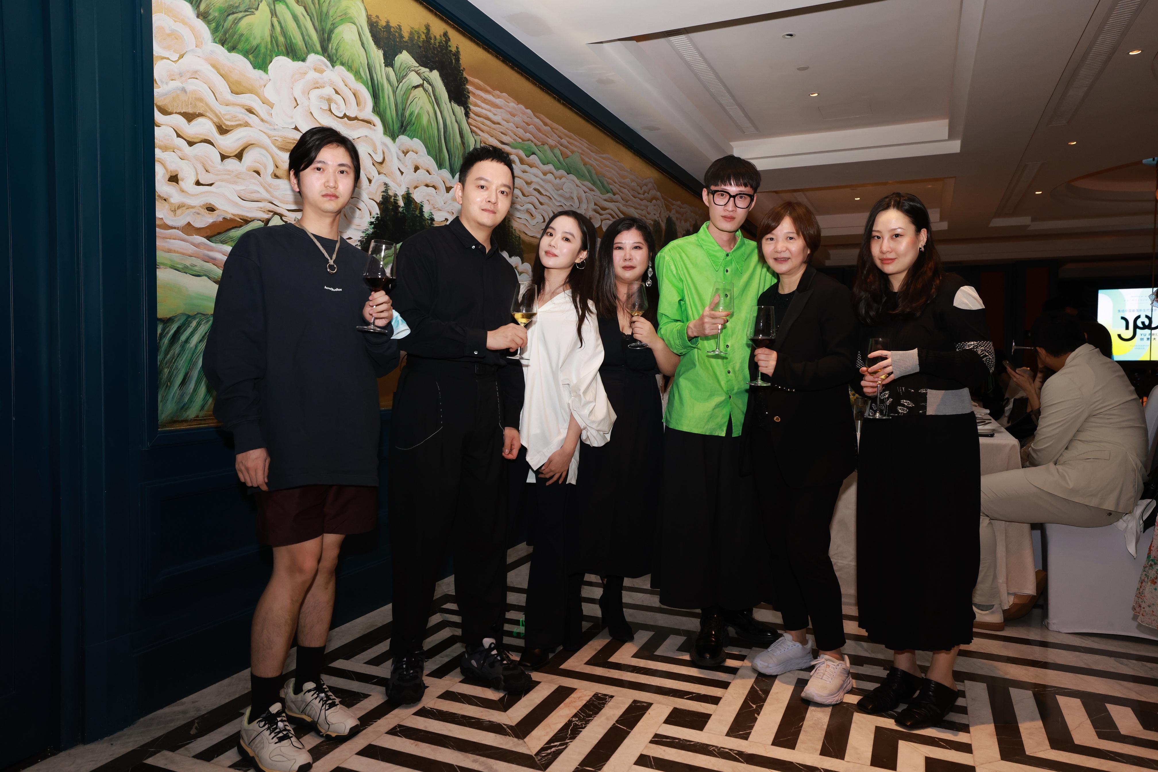 From left: designers Wei Ge, Zhang Aoyu, Chen Danqi, Huang Wanbing, Madame Lv, secretary general of Shanghai Fashion Week, and designer Guo Yirantian.
